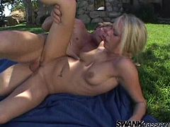 Blonde takes cumshot after being bonked cowgirl style in an outdoors scene