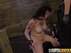 A brunette lady with a punkish haircut has her molded dress ripped off, by two dominant babes. The naked tattooed bitch has been fiercely enchained. The helpless sex slave has to suck strap on and it seems, that she likes it... especially when in the same time, the other slut fucks her from behind. Enjoy!