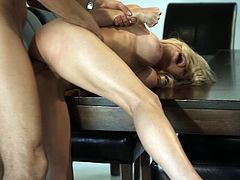 Fascinating blonde with fake tits awarding huge dick with handjob