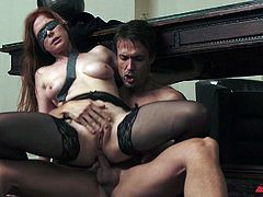 A kinky girl in a blindfold and stockings gets fucked
