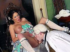 Raven haired busty babe Emily B is a smoking hot medieval beauty with perfect big melons and tight shaved pussy. She gets  her pink slit hammered by sex obsessed Danny D in the middle of the room.