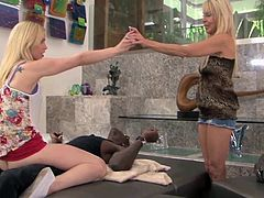 erica and tara take turns riding a big black cock