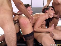 Brunette gets stuffed in all of her holes at the same time