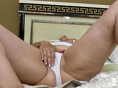 This chubby old mature woman plays with her old cunt and gets herself nice and horny. She plays with her natural saggy tits and rubs her wet pussy. Watch as this short haired old granny takes off all her clothes and cums.