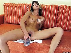 Brunette Doris Ivy strips down to her bare skin for your viewing entertainment