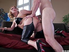 Pretty housewife turns into a naughty leather clad slut for anal sex