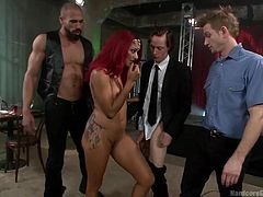 sexy redhead entices them to a gangbang