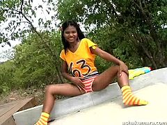 Asha is feeling kinky and naughty today, so she goes outside in just a t shirt and cute panties. The lovely young girl pulls down her underwear, to show off her sweet butt cheeks. The Indian hottie rubs her crotch so sensually!