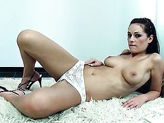 Dana Weyron with massive tits and trimmed pussy strips down to her bare skin