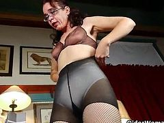 Skinny mature tries on her new fishnet pantyhose