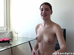 Czech brunette babe soaks herself in piss and enjoys pissing on camera before masturbating