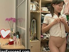 Courtesy of Real Asian Exposed you can see how a cute Asian brunette teen masturbates for you while wearing a lovely schoolgirl uniform in this free porn video.