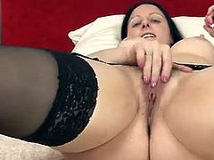 Mom next door Amber Lustfull is wearing her sexy black bra and panties and here she showcase her lovely goodies as she is teasing naked before proceeding on masturbating.