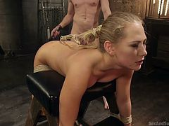 Billy is having fun in his basement with his new doll, Carter Cruise. This hot blonde has a tight bubble butt, which Billy placed nicely after doing tons of crafty tying work with the ropes. As the slut's position seem fitting to him, he stopped toying her butt hole and put his cock in her mouth.
