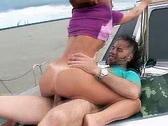 Redhead with pigtails Kimberly blows and rides strong dick on the yacht