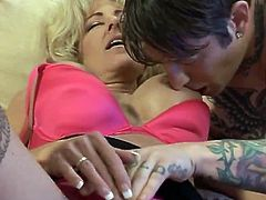 Classy mature chick letting her boytoy finger fucking her old pussy as she can get easily wet with her boytoy's fingers and she immediately gets down on her knees to suck him.