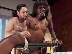 When this black babe is tied to the bed, the master can have his way with her. He fucks her really hard from behind, because she is a submissive slave, who likes to get fucked hard. Her nipples are clamped with a chain in her mouth. She has to tug on her nipples, as she gets fucked hard.