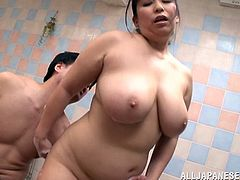 This chubby, mature Asian girl loves getting fucked in the bath