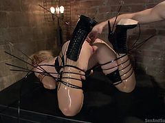 Slutty Darling doesn't run away from kinky hardcore activities. On the contrary, she gladly embraces every sadistic fantasy, implying strong bonding and submission. The blonde horny bitch enjoys being banged hard from behind. She wears a sexy provocative latex outfit. Watch her getting fucked in the ass!