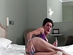 Mature hottie on heels shoving a vibrator deep in her pussy