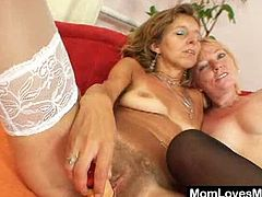 These mature mommys are very slutty, they need to fuck too so because there's no cock around these sluts are fucking each other. Watch as one of them starts licking the other ones hairy vagina, spreading those pussy lips so we can see that mature cunt. We wonder if there's a boy willing to fuck two mommys.