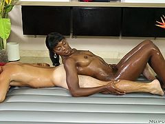 This lovely black slut rubs her sexy dark body all over her man's skin to make him feel horny and relaxed. She is working on his cock in the tub and sucking him off really good. She is skilled at massage and blowjobs.