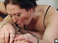 Handcuffed brunette chick gets nailed both missionary and doggy styles