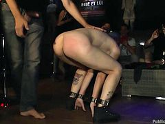 This naughty girl is humiliated and disgraced in public by her master. He makes her get on her knees and balance an ashtray for the mistress. The slut slave is masked and fucked hard from behind by the master.