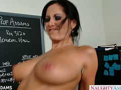 Sexy teacher Ava Addams in glasses is alone with the good looking student and being horny as she was she let him peek on her titties and pussy making him fuck her at the teacher's table.