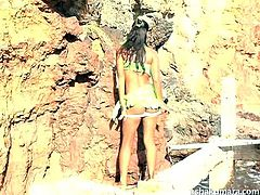 She is outdoors enjoying nature and looking sexy as usual. The Indian hottie shows off her sexy body and outfit, as she poses by the cliffs. Watch as she lifts up her skirt and shows off her cute cotton panties, before pulling them down and showing off her very cute butt.