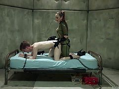Bella has her slave tied to the bed and she fucks his tight asshole hard with her strap on. Look how she is stretching his ass wide. She wrapped her latex covered gloved hands around his cock and jacked him off hard. Finally, she uses the sex machine on his dong.