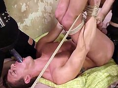 They warm his ass up with their fingers. Once his ass is stretched, he is ready to take the big black strap on into his butthole. The mistresses love playing with his anus. They tie him tightly with rope and use his bum.