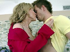 blonde mature woman plays with cock