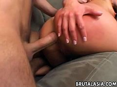 Asian lass is spitroasted by two aroused dudes