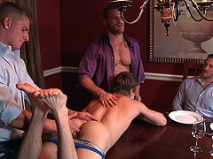 Three hot guys were chatting and eating at the table, while the slutty cute twink Johnny entered and started rubbing their shoulders, to invite all of them into a foursome. Dude sucked all of their hard dicks and got his ass fingered pretty well. The guys also kiss each other, before they started fucking.