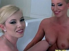 Donna Bell and a blonde take a naughty bath together