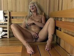 Naughty blonde milf Holly, feels so horny, that she fingers and moans alone in the sauna room. Big boobied ebony tranny, Natassia, is also having a private time there. As these two pair of big boobs meet each other, Holly gets happy to find a dark hard cock and starts sucking it immediately!