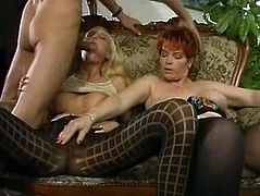 German mature and MILF in nylons sharing a cock