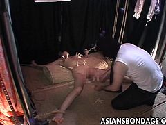 Asian whore is roped up by her master and already gets a rough treatment as she is pussy whipped and waxed by the slave master. She for some reason likes it.