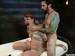 Tattooed master fucks intensively tied up brunette with gag in her mouth hole
