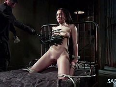 Gabriella is one hell of a sexy chick and there is no guy, who would not like to stick his dick inside her pink pussy. That's why she gets taken away to a dungeon and tied to a bed. The man stuffs a big dildo in her cunt and clamps her nipples. Gabriella loves it and screams for even more torture, after all, it makes her pussy wet with cum.