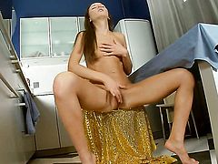 With tiny breasts and smooth twat having fun with sex toy