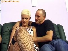 Checkout this busty blonde mature babe in stockings, sucking and fucking two fat cocks. Watch her getting banged by these two eager cocks, she sucks one cock while the other guy bangs her from the back.