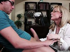 Nina Hartley demonstrates her naughty bits while getting fucked good and hard by Xander Corvus