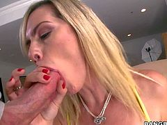 Tara Lynn Foxx is one nasty blonde with natural boobs that bangs herself with black dildo and gives deep throat job right in front of the camera. She polishes hard dick with her hot lips until guy gets enough!