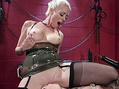 Busty naked blonde is getting her body oiled and wet pink pussy vibrated, since her majestic mistress is all about enjoying the dominating lesbian love. The sexy blonde mistress in stockings, sits on her slave's face and gets her pussy licked properly. Looks like she is about to whip more action!