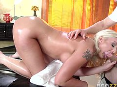 Leya is a naughty blonde milf, who is getting her busty body massaged by horny masseur, Erik. While her husband was sitting right outside the room, she gets her body oiled and pussy fingered, before sucking his cock, and getting nailed hard & deep.