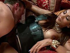 Abel is a tranny lover and he has mistress with a cock, who loves to dominate her minion. Watch the guy in a collar, sucking the ladyboy Yasmin's feet and getting teased. Her big boobs make him horny and he starts sucking the shemale's hard cock. Let's see how she fucks her fag Abel's tight asshole.