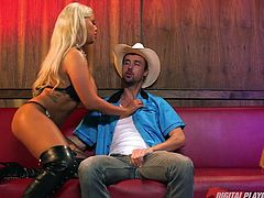 All that slutty Bridgette wants and needs, is a cowboy's cock. After a short interlude of persuasion, the blonde bitch with impressive tits gets down on knees, to offer an unforgettable blowjob to her hero. Click to see the horny milf ready for a kinky