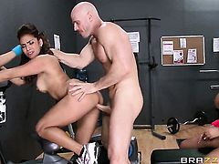Johnny Sins buries his rock solid rod in incredibly sexy Nikki Delanos mouth